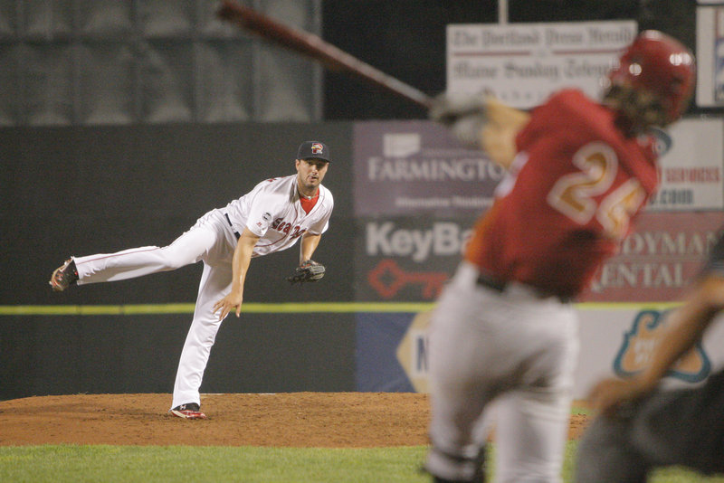 Sea Dogs pitcher Brandon Workman strikes out a batter in his first outing at the AA level.