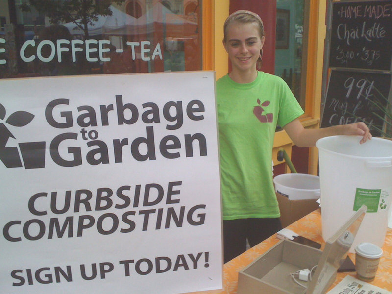 Sable Sanborn staffs the Garbage to Garden sign-up table at the Portland Farmers Market in Monument Square. She and her partner, Tyler Frank, offer curbside pickup of compost materials in Portland, South Portland and Falmouth.