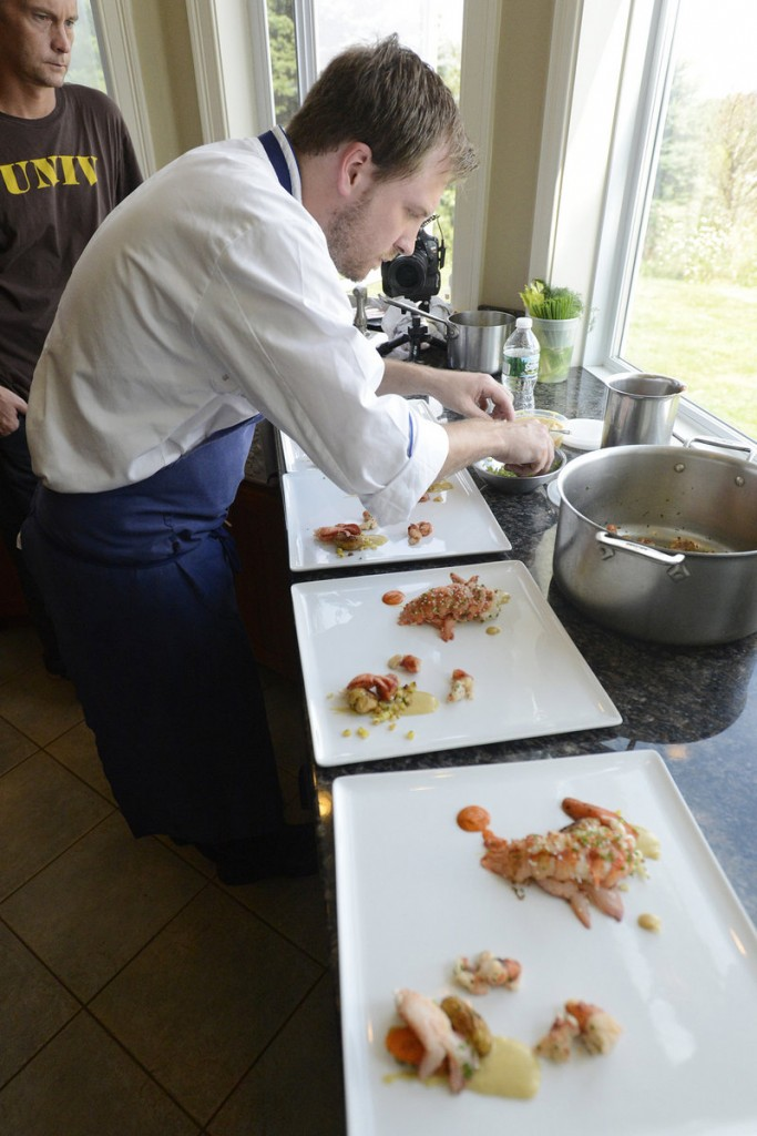 "The competition's winner, a Maine native who recently worked at Uni Sashimi Bar in Boston, prepares a dish that included butter-poached lobster with ragout of sauteed knuckles, roasted fingerling potatoes, cinnamon-roasted carrots, roasted corn and sweet miso puree, and piquillo pepper. Gould said he plans to open his own restaurant in Portland next spring that will feature ""internationally inspired small plates."""