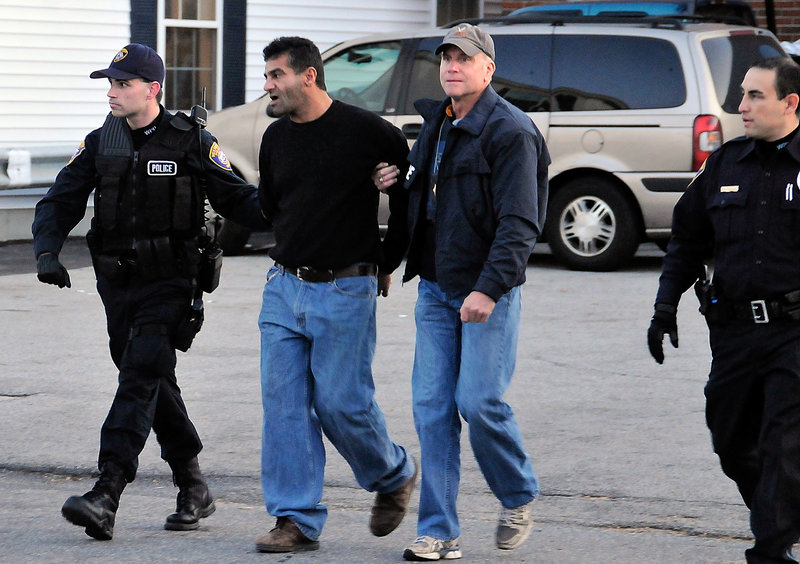 Scott Durst, in jacket, and Westbrook Police officers arrest Abbas Al-Hamdany on a drug charge in Westbrook. From left are Patrolman Steven Goldberg, Al-Hamdany, Durst and Patrolman Gus Rodriguez.