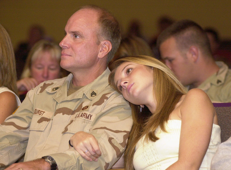 Staff Sgt. Scott Durst and his daughter, Devin, then 17, at his unit's homecoming ceremony at Thornton Academy in Saco in 2004.