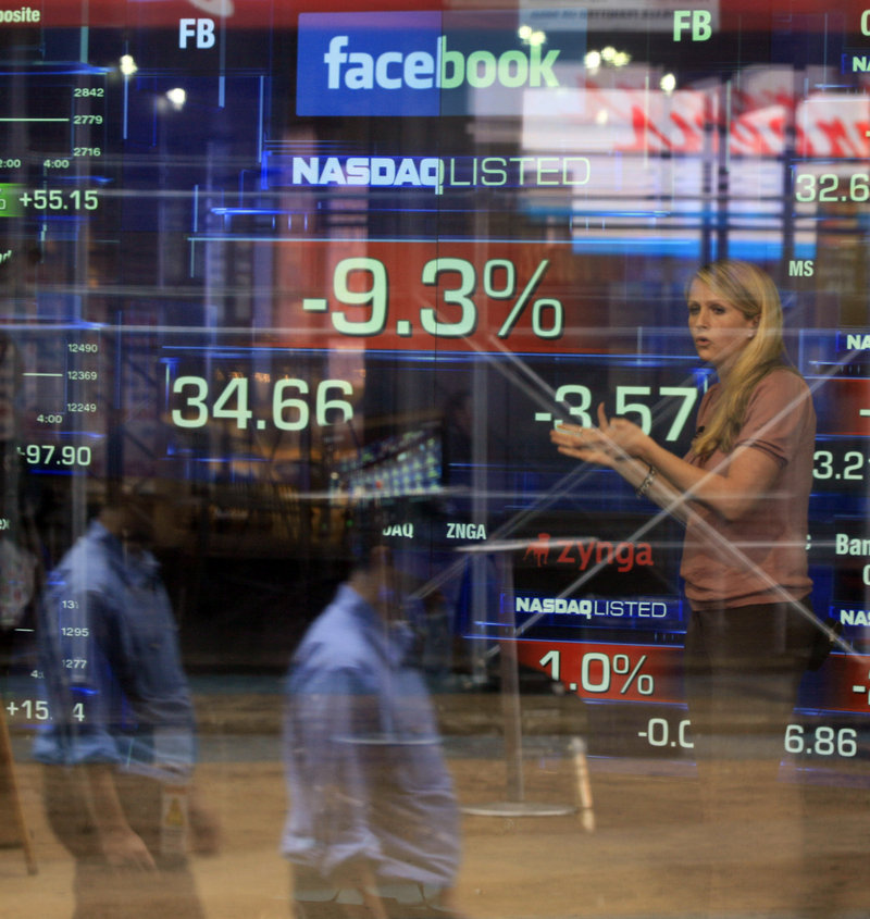 Television correspondent Sabrina Quagliozzi reports from inside the Nasdaq MarketSite in New York on May 21, a few days after Facebook's stock IPO. The shares closed Thursday at $19.87, down $1.33 for the day, or more than 6 percent, and nearly half the original price of $38.