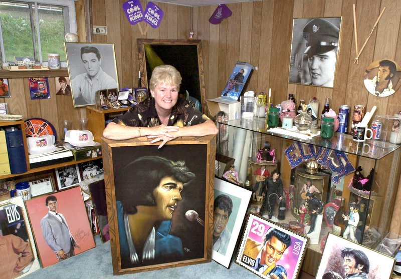 Dot Gonyea, shown here in the Elvis room of her South Portland home in 2004, is in Memphis this week to observe the 35th anniversary of the pop idol's death. She spent two days and nights in line at the Civic Center to get tickets to his Portland show.