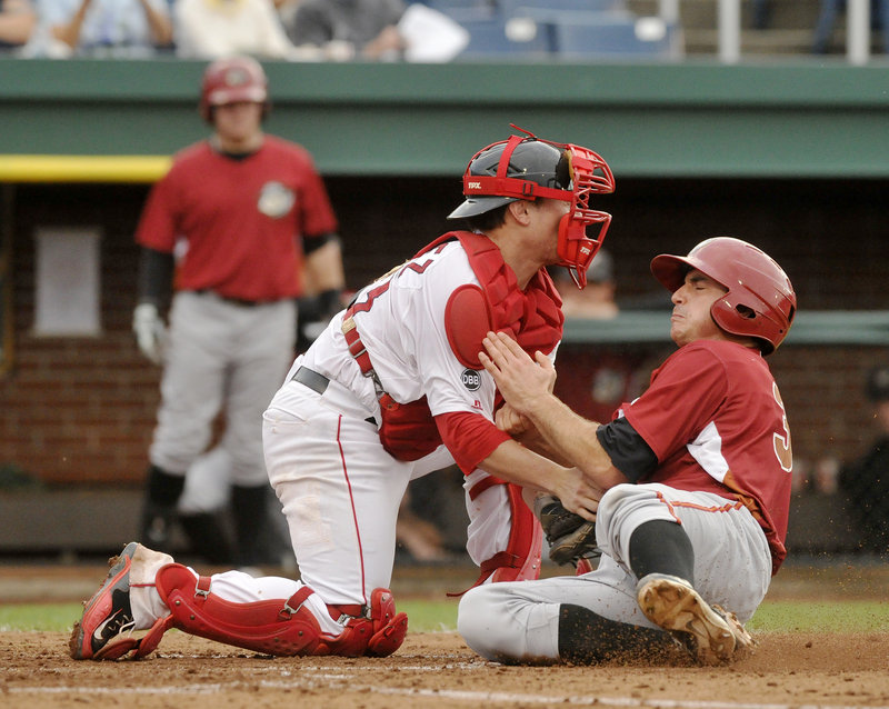 Charlie Cutler of the Altoona Curve is cut down at the plate on a throw from left fielder Peter Hissey – a key moment Thursday night in a 2-1 victory for the Portland Sea Dogs. Applying the tag is catcher Christian Vazquez.