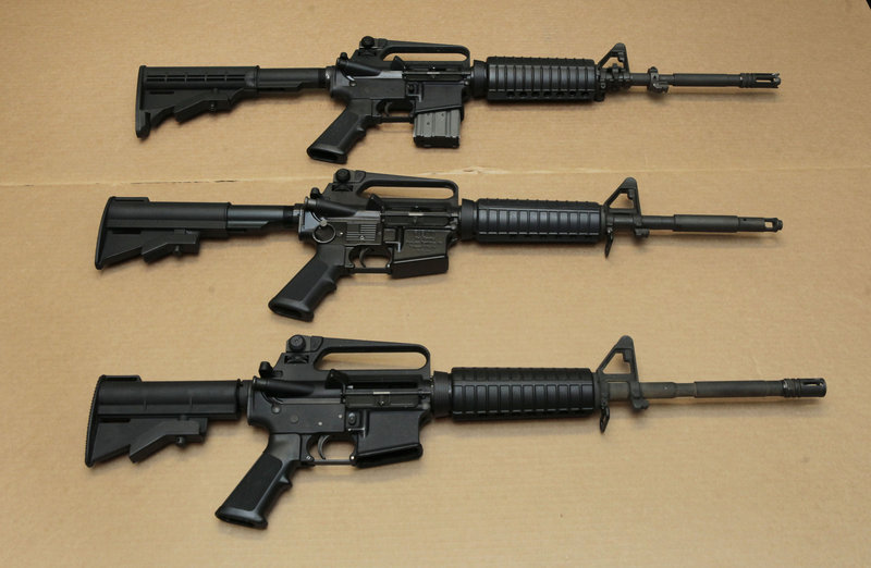 Three variations of the AR-15 assault rifle are displayed Wednesday at the California Department of Justice. Although the guns look similar, the bottom version is illegal in California because of its quick-reload capabilities.