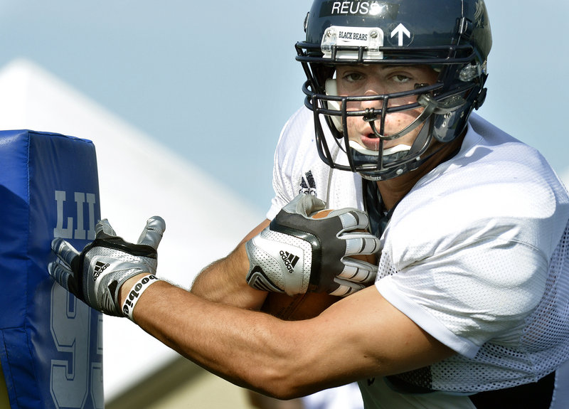 Sean Reuss, a tight end for the University of Maine, works through a drill Friday at practice. The Black Bears will be looking for another strong season after going 9-4 a year ago and earning a berth in the NCAA playoffs.