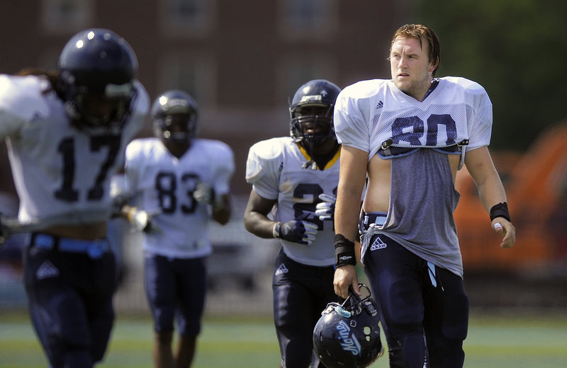 Justin Perillo, right, rose from third to first on the UMaine tight end depth chart last year and did such a bang-up job, he was named a preseason All-American this year.
