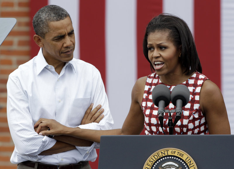 President Obama and his wife campaign together last week in Dubuque, Iowa. The first couple have been sharing their personal narratives on the campaign trail, trying to counter Republican attacks.