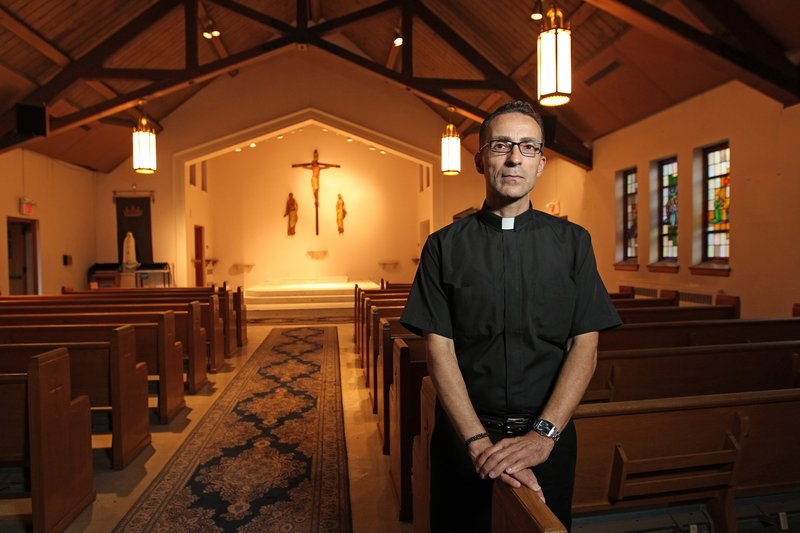 The Rev. Joseph Capella is shown in the sanctuary of the now-closed Our Lady of Grace church in Somerdale, N.J.