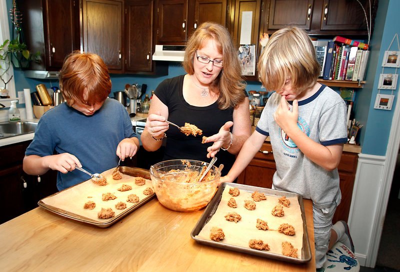 Krista Haapala makes cookies with her children, Evan, 8, right, who will be a fourth-grader at Hall Elementary School, and Ethan, 11, who attended the school, at their Portland home on Friday. Haapala hopes the school's test results will serve as a catalyst for action.