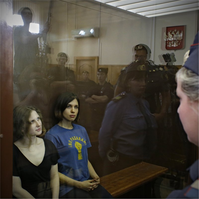 Maria Alekhina, left, and Nadezhda Tolokonnikova, two of the three members of the Russian feminist punk rock group Pussy Riot, sit in a glass cage in a Moscow courtroom Friday. The case ended Friday with three band members' conviction for hooliganism and sentences of two years each in prison.