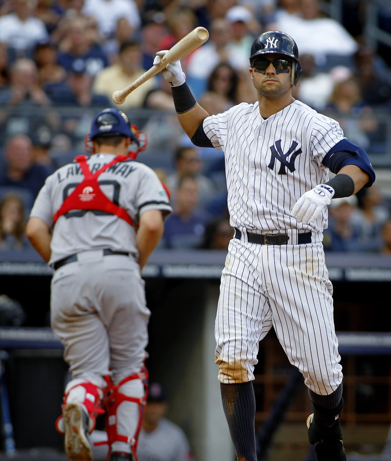 Nick Swisher of the New York Yankees shows his disgust Saturday after striking out to end the fifth inning at Yankee Stadium. Red Sox catcher Ryan Lavarnway heads to the dugout. All part of a 4-1 victory for the Red Sox.
