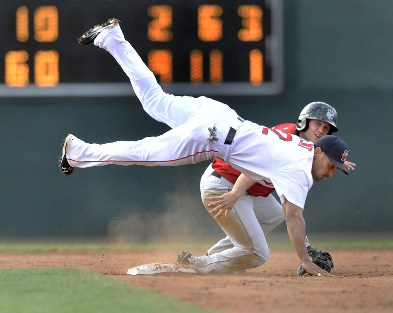 Sea Dogs second baseman Ryan Dent gets upended by Rene Tosoni of the New Britain Rock Cats but still completes a double play to end a 9-2 win in Game 1 of Saturday's doubleheader.