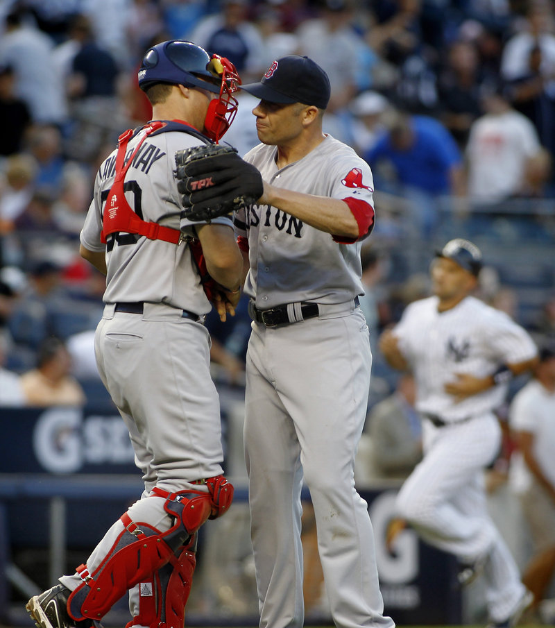 Alfredo Aceves, right, is congratulated by catcher Ryan Lavarnway after closing out a 4-1 win Saturday for the Red Sox over the Yankees.