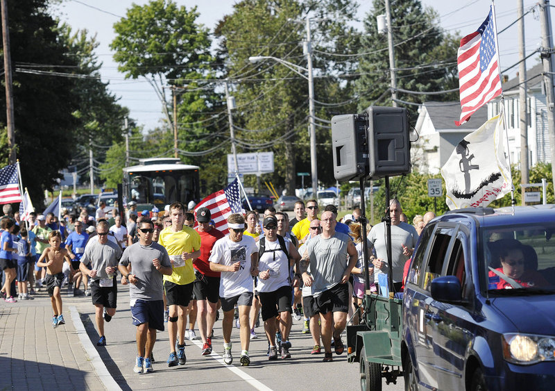 Runners participating in the fifth Run for the Fallen make their way up Route 1 in Wells on Sunday. The 65-kilometer course stretches from Ogunquit to Portland.