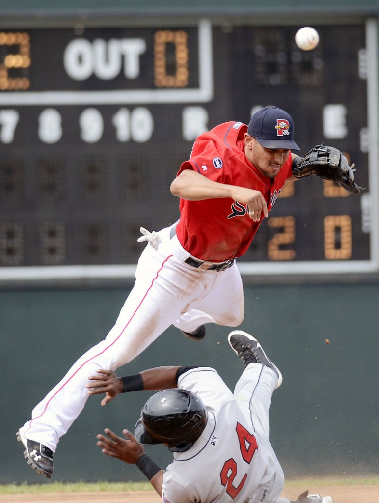 Sea Dogs second baseman Ryan Dent gets upended by New Britain's Deibinson Romero, but not in time to prevent Dent from turning a double play during Portland's 7-4 win Sunday at Hadlock Field.