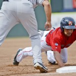 Ryan Dent dives safely back to first base as New Britain's Chris Colabello fields the pickoff attempt. The Sea Dogs wrapped up a 5-1 homestand and improved to 18-5 at Hadlock Field since the Eastern League All-Star break.