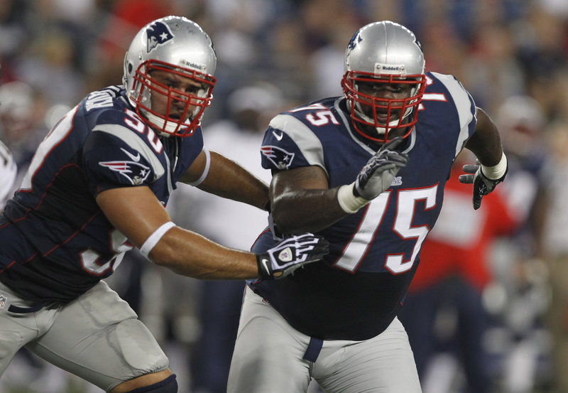 Rob Ninkovich, left, was moved to linebacker when he joined the Patriots in 2009, but this year he'll be lining up next to Vince Wilfork as a defensive end.