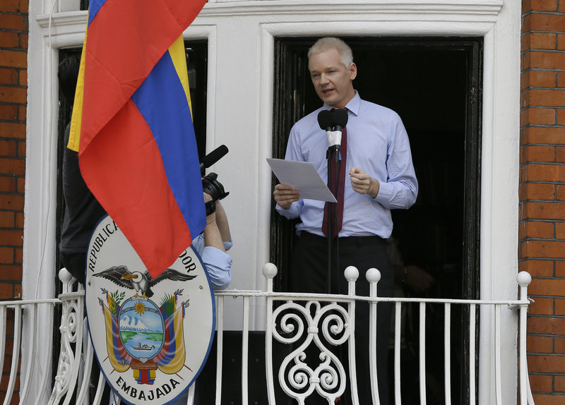 Julian Assange, founder of WikiLeaks, issues a statement Sunday from a balcony of the Ecuadorean Embassy in London. He accused the U.S. of targeting him for revealing secrets.