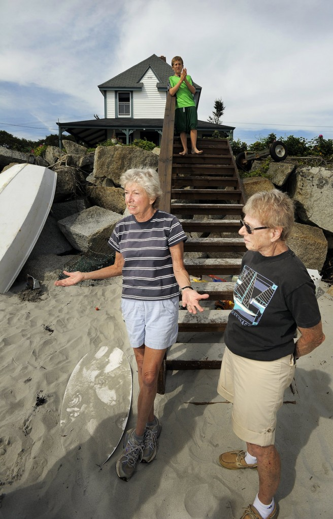 Ann Pick of Minnesota, left, and Barbara Young of Arizona stand in front of one of two houses their family owns on Goose Rocks Beach on Monday. Both Pick and Young said they believe the current right of access to the beach should stay unchanged.