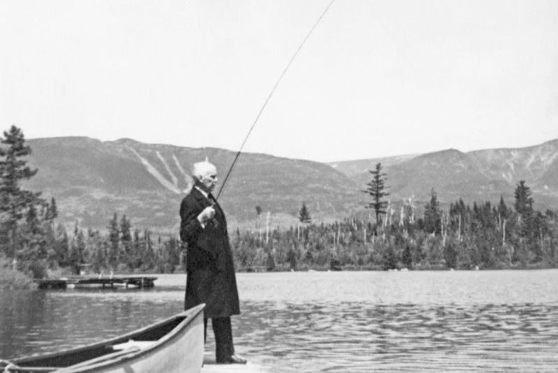 "Gov. Percival Baxter fly fishes in Kidney Pond with Mount O.J.I. in the background at Baxter State Park, for which he donated the first parcel in 1931. The photo is from ""Baxter State Park and Katahdin,"" by John W. Neff and Howard R. Whitcomb."