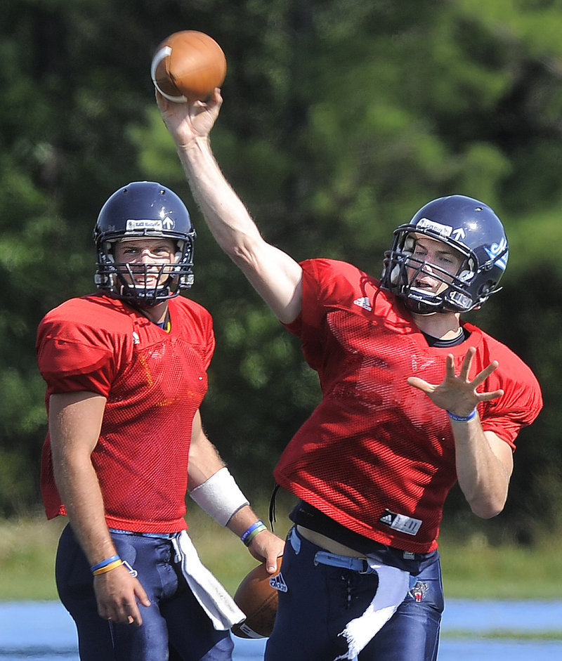 UMaine quarterbacks Marcus Wasilewski, left, and John Ebeling are battling for the starting job when the season opens Sept. 8 at Boston College.