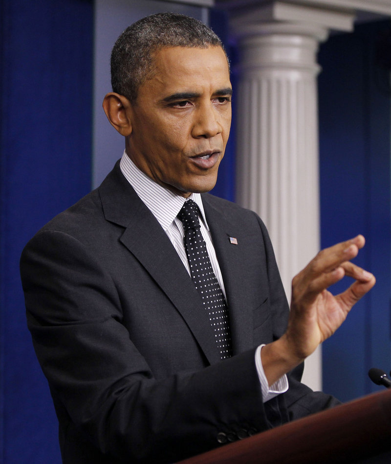 President Obama gestures while speaking in the White House briefing room in Washington on Monday. Obama defended the tone of his campaign for re-election.