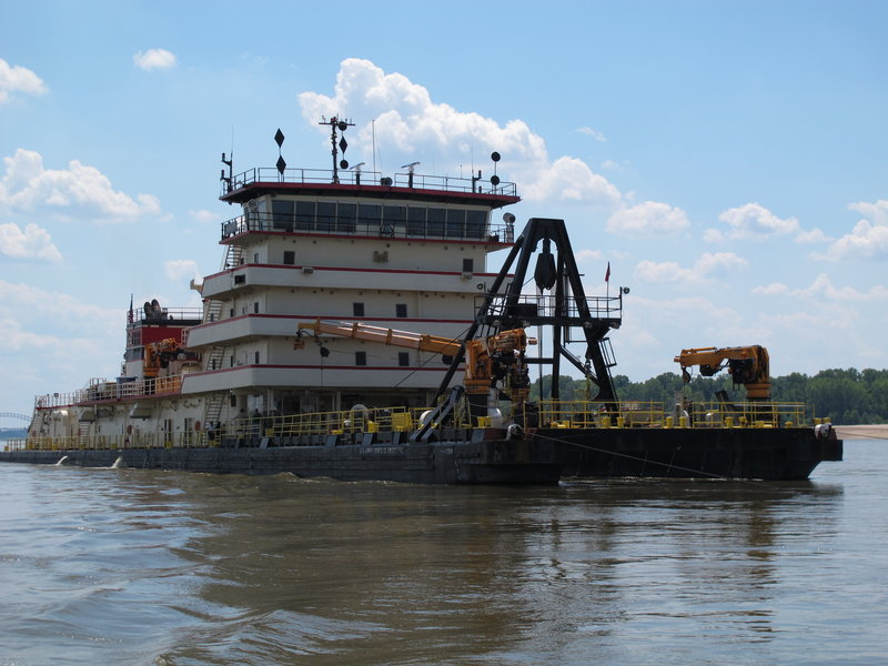 An Army Corps of Engineers' dredge works to clear a navigation channel Monday on the Mississippi near Memphis, Tenn. An 11-mile stretch is closed near Greenville, Miss.