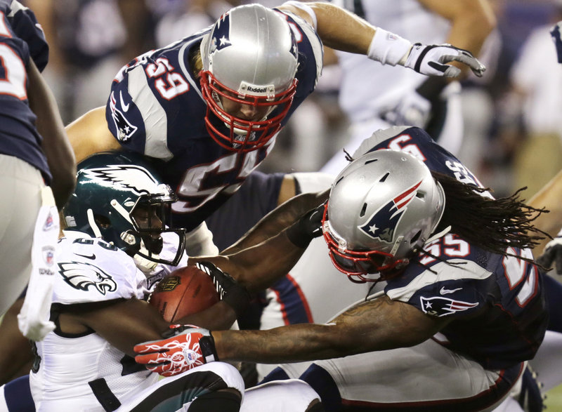 Brandon Spikes, 55, and Bobby Carpenter of the Patriots stop Philadelphia Eagles running back LeSean McCoy in Monday night's preseason game at Foxborough, Mass. The Eagles won, 27-17.