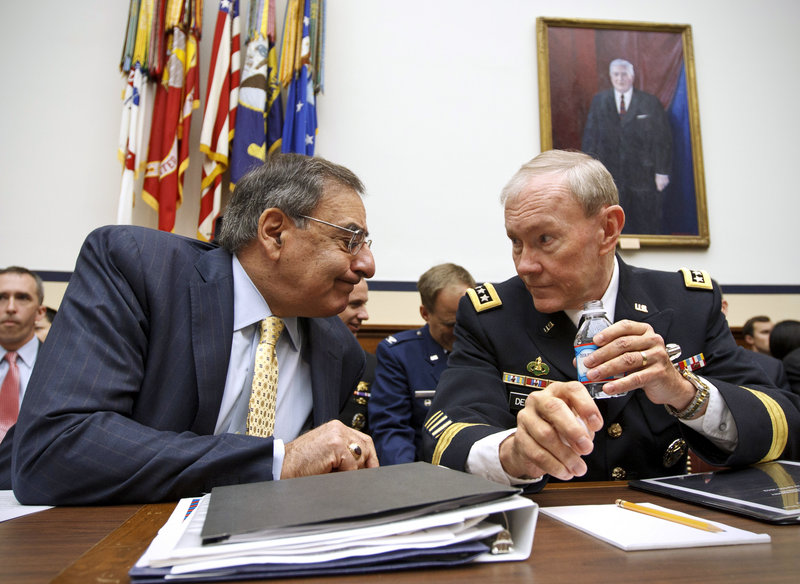 Defense Secretary Leon Panetta, left, and Joint Chiefs Chairman Gen. Martin Dempsey confer at a hearing. Panetta called Afghan President Hamid Karzai on Saturday to express concern about the deaths of U.S. mentors at the hands of their Afghan trainees.