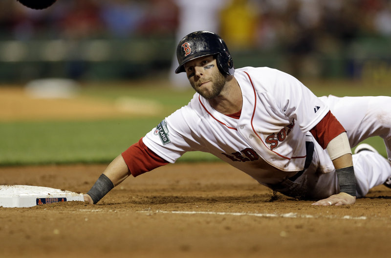 Dustin Pedroia of the Boston Red Sox gets back safely to first on a pickoff attempt Tuesday night during the 5-3 loss to the Los Angeles Angels at Fenway Park. The Red Sox, playing the team directly in front in the wild-card standings, have lost the opener in eight of their last 10 series.