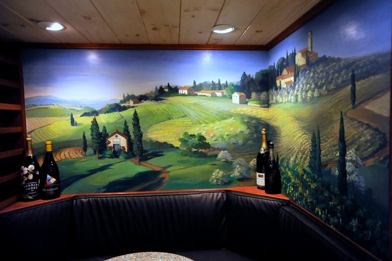 Patrons dining in the wine cellar at the White Barn Inn can admire a mural of Tuscany painted by local artist Judith Hardenbrook.