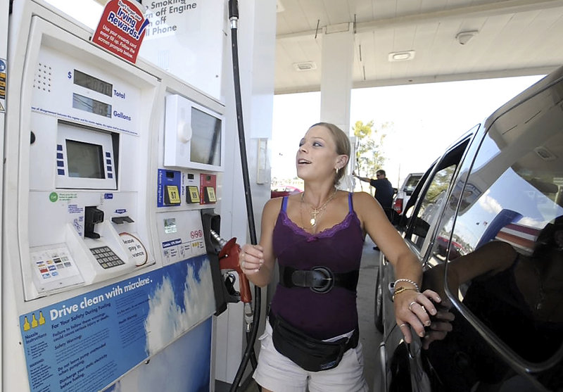 Andrea Colon of Scarborough gets some preseason football news from the pump video screen as she fills up at the Irving Station on Western Avenue on Tuesday.