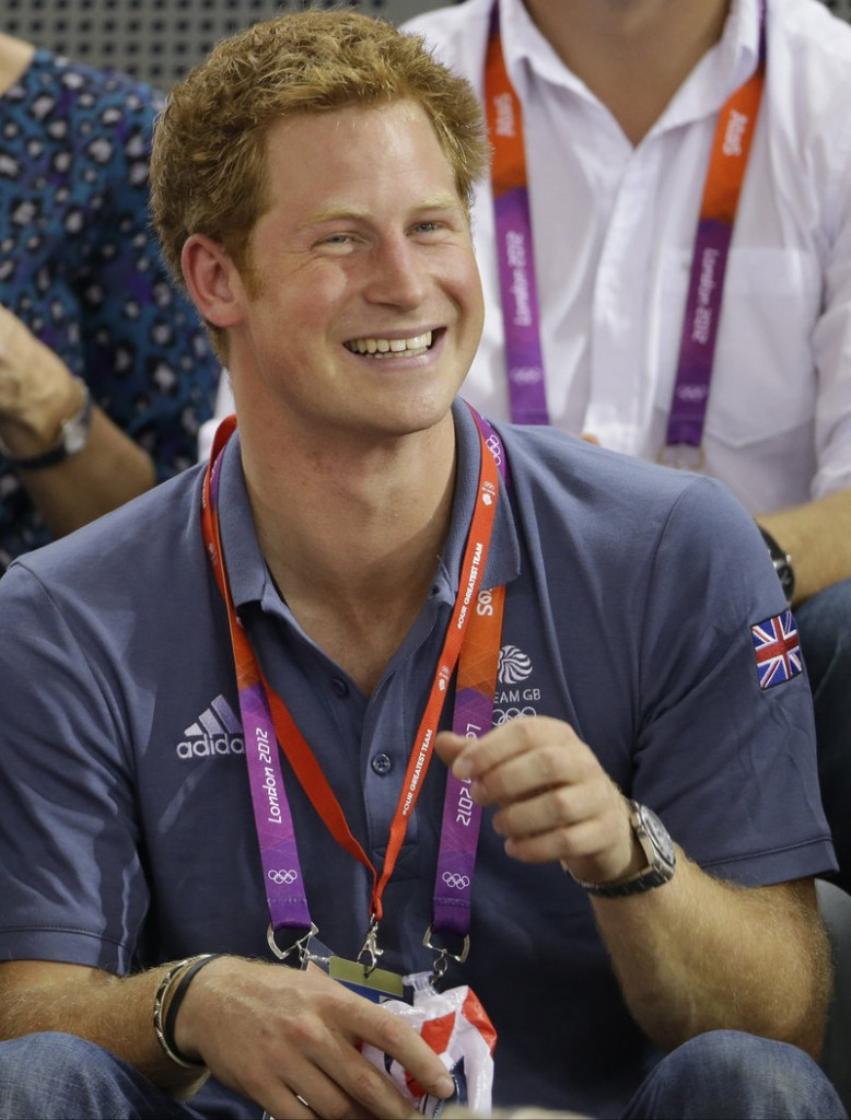 "Prince Harry is ""on his way home"" from the U.S. after pictures of him in a compromising position appeared online."