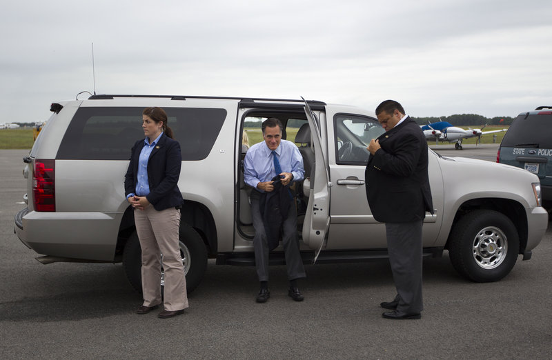 Republican presidential candidate Mitt Romney, arrives at the airport in Martha's Vineyard for a fundraising event last Saturday. With the national GOP convention set for next week, distractions abound.