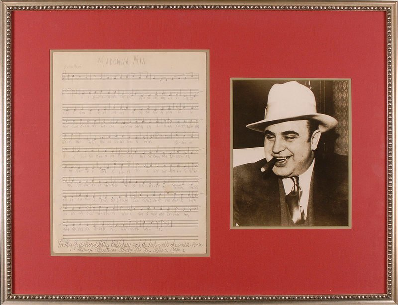 "This photo from RR Auction in Amherst, N.H., shows a photograph of Al Capone and his hand-written score for ""Madonna Mia,"" a love song he wrote to his wife while he was in prison on Alcatraz. The items will be auctioned Sept. 30."