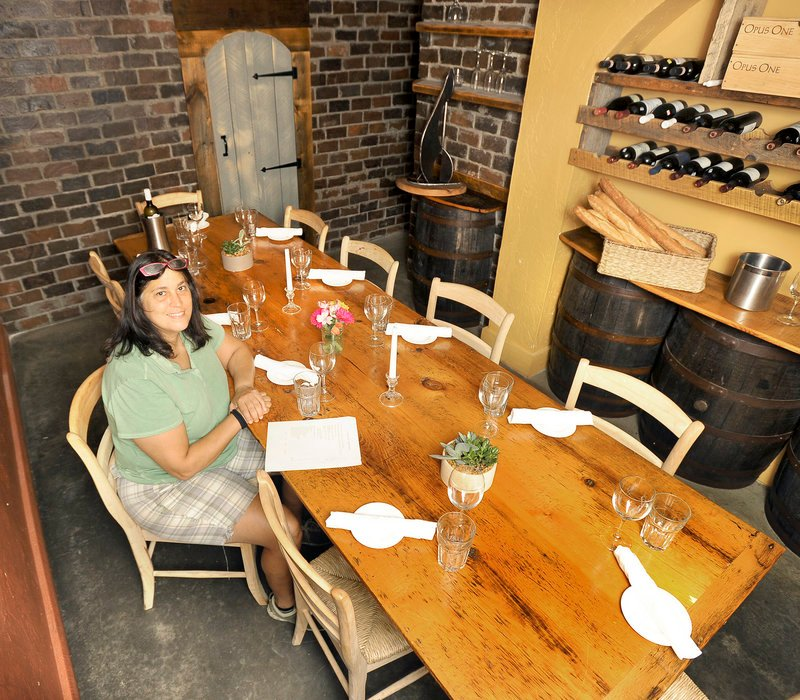 Lisa Vaccaro, co-owner of Caiola's, fashioned the table for the wine cellar herself from two wide planks. The wood came from either an old house on Washington Avenue or an old barn near Lubec; she's not sure which.