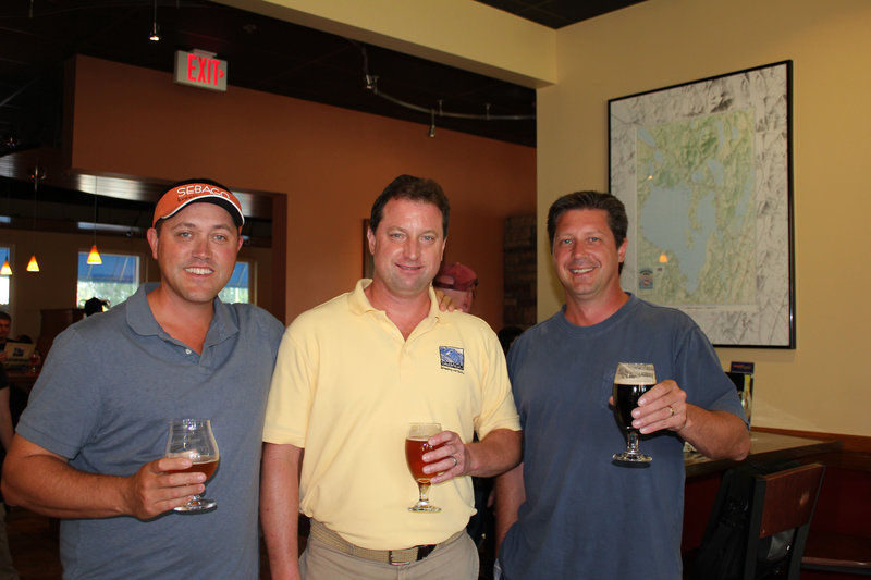 Founders of Sebago Brewing Company, from left, Kai Adams, Brad Monarch and Tim Haines, at the event held at their Scarborough restaurant.