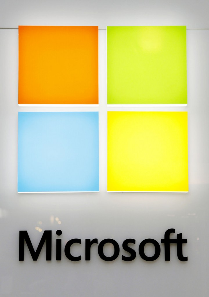 A new Microsoft logo is seen on a wall of a newly opened Microsoft store in Boston on Thursday. The new logo marks the first time that Microsoft Corp. has revamped its logo in 25 years.