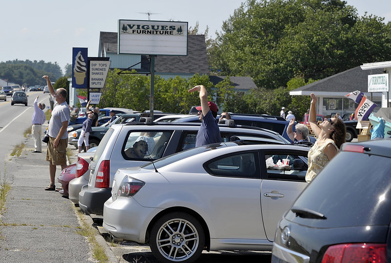 Parking lots at businesses along Bath Road in Brunswick filled with people checking out the U.S. Air Force's Thunderbirds as they practiced Thursday for the Great State of Maine Air Show this weekend. The event, a boon to local business, takes place at Brunswick Landing.