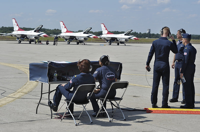 Members of the Air Force communication team help the pilots and support staff prepare Thursday for a trial run of the Great State of Maine Air Show at Brunswick Landing. Three of the eight Air Force Thunderbirds are lined up here and ready to go.