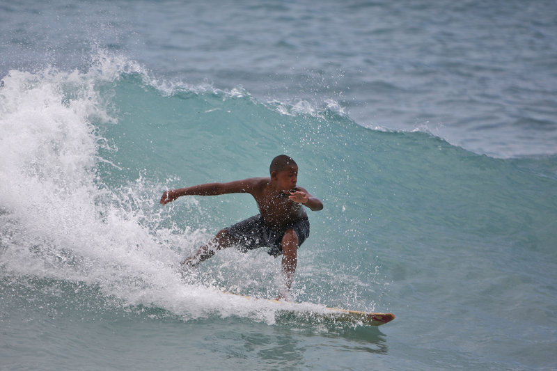A boy surfs a wave at a beach in Barahona, Dominican Republic, before the anticipated arrival of Tropical Storm Isaac on Thursday. U.S. forecasters said Isaac will likely turn into a Category 1 hurricane by Friday as it nears the Dominican Republic and Haiti.