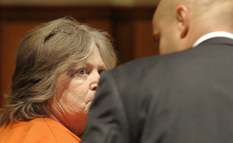 Carol Field, 66, of Standish, listens to J.P. DeGrinney, her court-appointed attorney, before pleading guilty to six counts of arson Thursday in Cumberland County Unified Criminal Court.