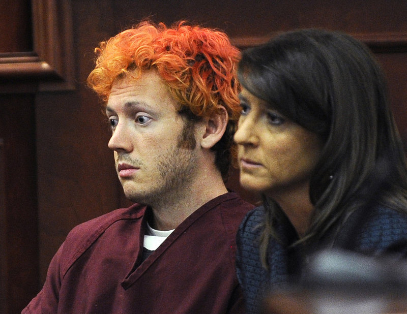 James Holmes, accused of killing 12 people in an Aurora, Colo., movie theater, appears in court with defense attorney Tamara Brady in Centennial, Colo., on July 23.