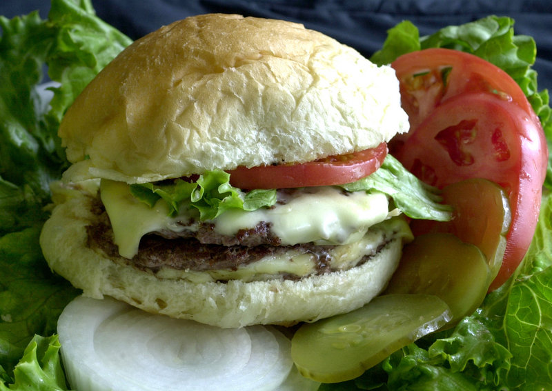 A cheeseburger is expected to cost more in 2013, but agriculture officials also predict U.S. consumption of red meat and poultry will fall below 200 pounds per person next year for the first time since 1990.
