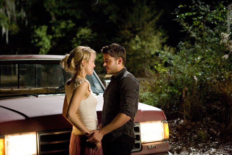"Taylor Schilling as Beth and Zac Efron as Logan in ""The Lucky One."""