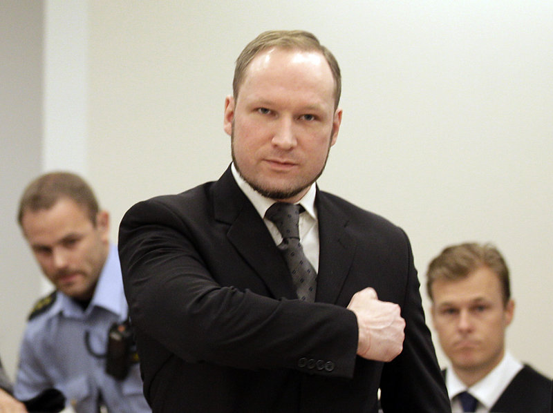 Norwegian Anders Behring Breivik gestures as he arrives Friday at the courtroom in Oslo, where he was sentenced to prison for twin attacks that killed 77 people last year.