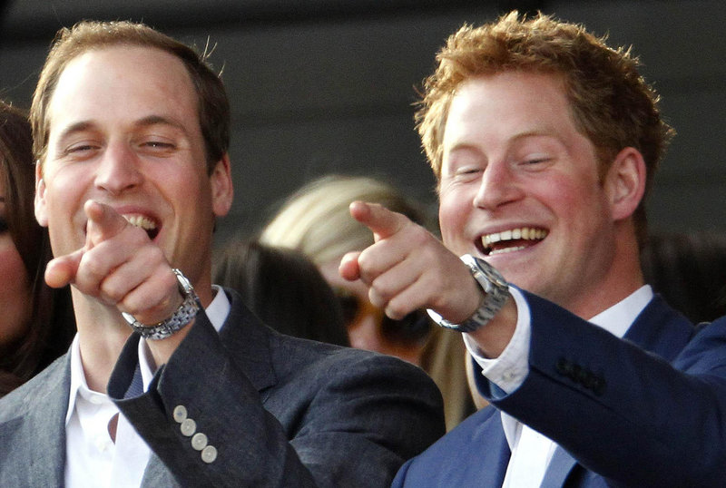 The Duke of Cambridge and his brother, Prince Harry, right, attend a concert in London on June 4. TMZ and The Sun have published nude photos of Harry.