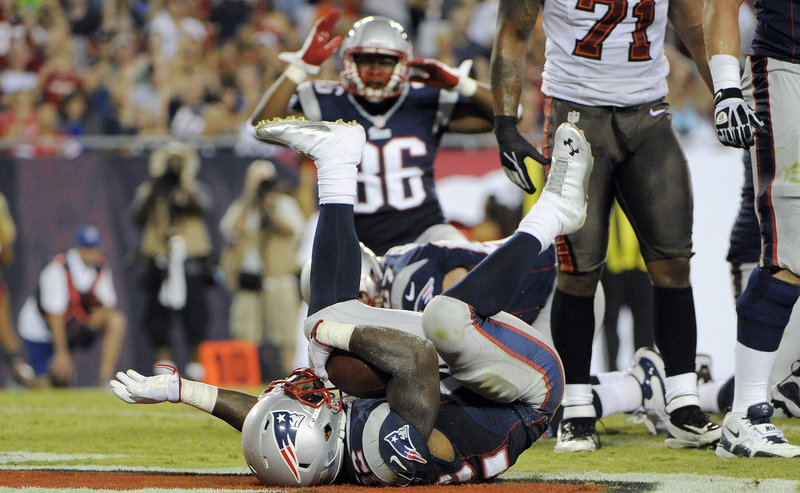 New England's Stevan Ridley tumbles into the end zone after his touchdown run in a 30-28 exhibition loss at the Tampa Bay Buccaneers on Friday night.