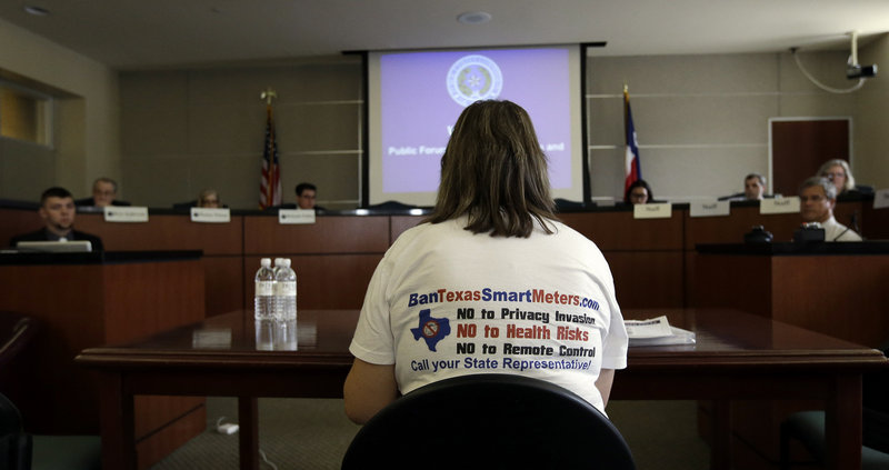 The Associated Press Members of the Texas Public Utility Commission listen to a speaker during a hearing last week in Austin examining the use of smart meters. Texas utilities have installed nearly 6 million smart meters, or 87 percent of their goal, but opposition is growing louder.